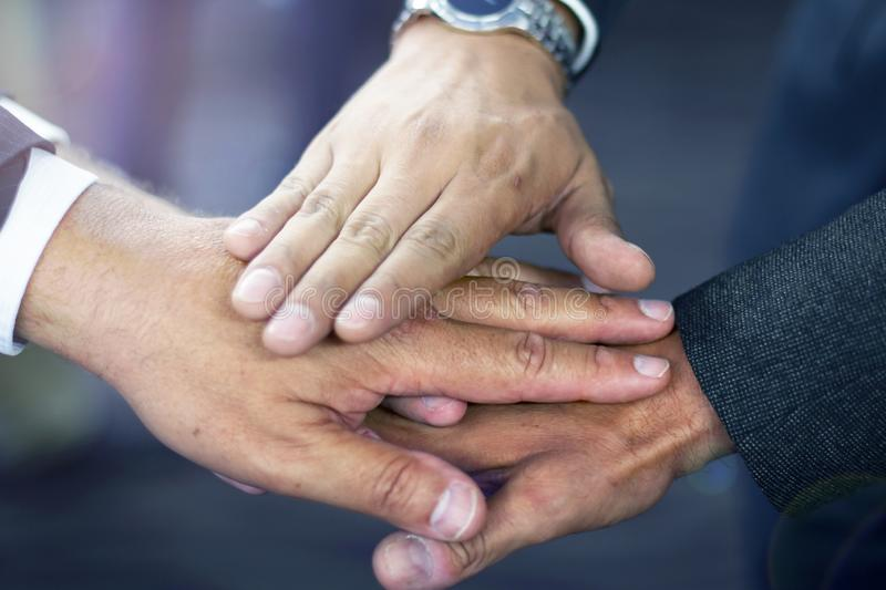 Close up of hispanic business man joining hands stock photography