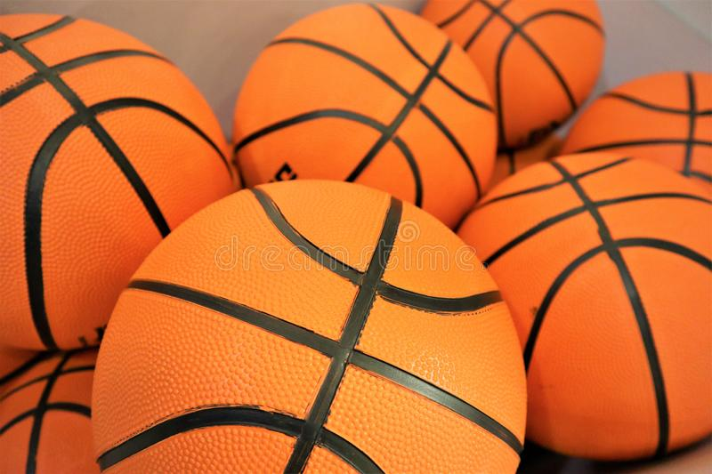 Close up of a group of many new basketball orange balls stock photography