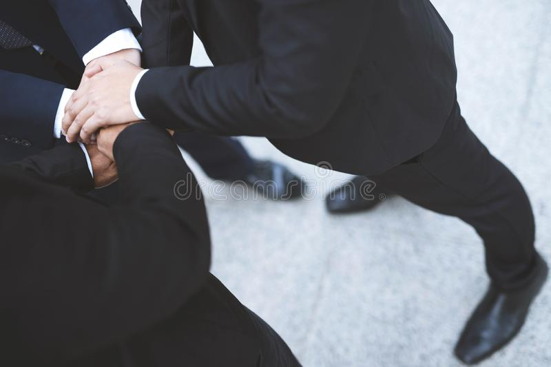 Close up of Group people of businessmen joining putting their hands together with stack of hands showing unity and teamwork. conce stock images