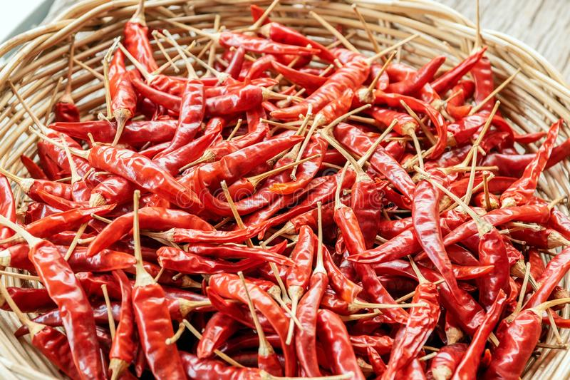 Dried peppers in a wicker basket stock images