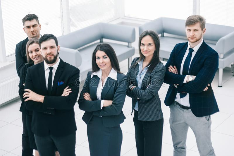 Close up.a group of successful business people standing in the office hall stock image