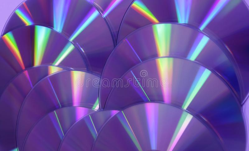 CD DVD disc colorful compact background rainbow shine color pantone ultra violet pink purple deep proton. Close up group of violet and purple DVD discs stock photography