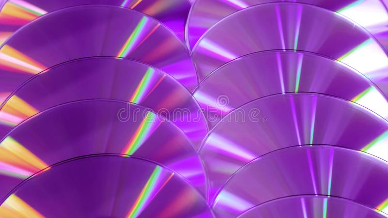 CD DVD disc colorful compact background rainbow shine color pantone ultra violet pink purple deep proton. Close up group of violet and purple DVD discs stock photos