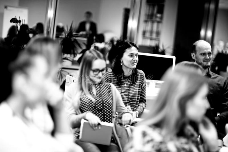 Group of women listening to a lecture at a business seminar stock photography