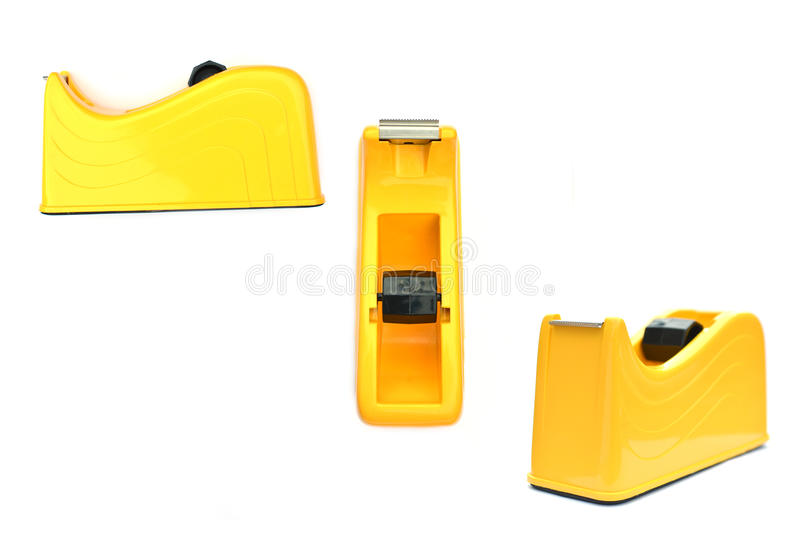 Close up of group yellow adhesive tape cutter royalty free stock images