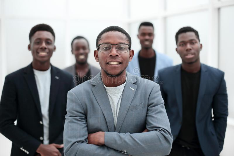 Group of young business people standing in the office lobby. stock photos