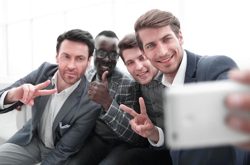 Close up.a group of young employees takes a selfie stock images