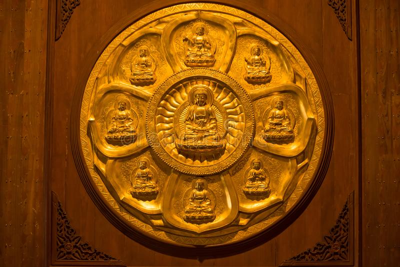 Close-up Groups of gold Buddha statue, stucco on chinese temple wall in Wat Leng Nei Yee 2 Temple, Bangkok, Thailand stock photos