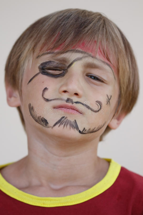 Close-up of grumpy pirate boy. A close-up portrait of a grumpy angry pirate boy stock images