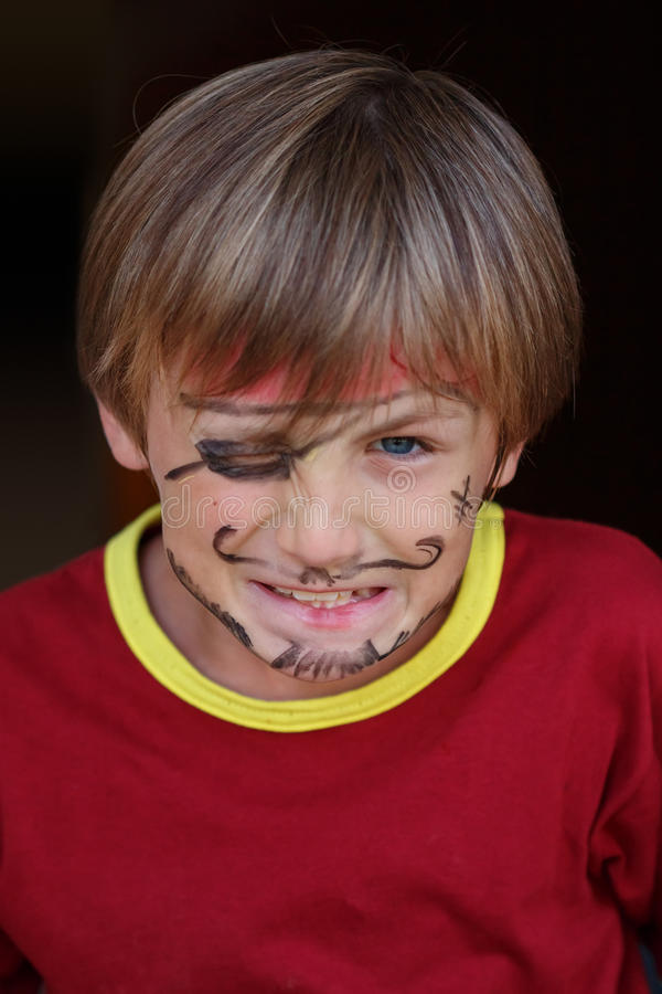 Close-up of grumpy pirate boy. A close-up portrait of a grumpy angry pirate boy royalty free stock photo