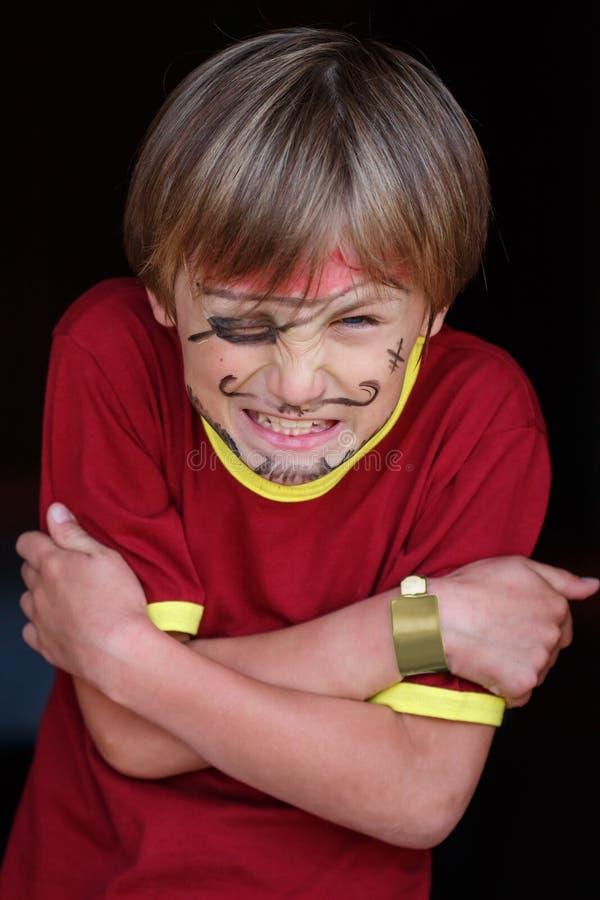 Close-up of grumpy pirate boy. A close-up portrait of a grumpy angry pirate boy stock photo