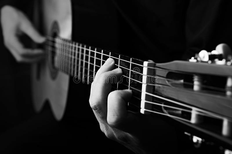 Close up of an guitar being played. Black and white photo stock photo
