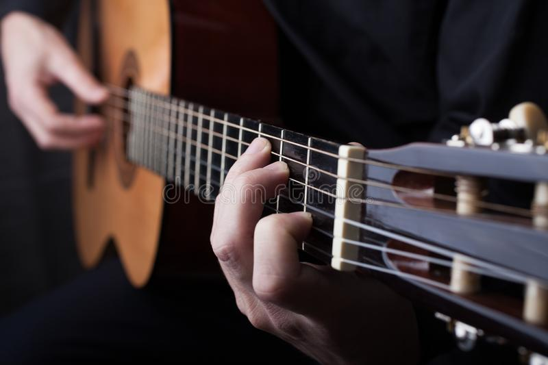 Close up of an guitar being played. Chord, fingers. Small DOF royalty free stock photos