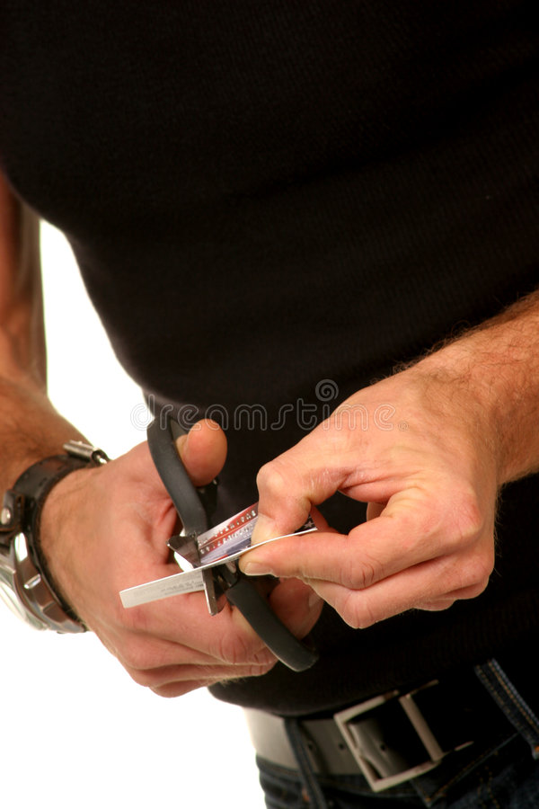 Close up of guy cutting up credit card royalty free stock photos