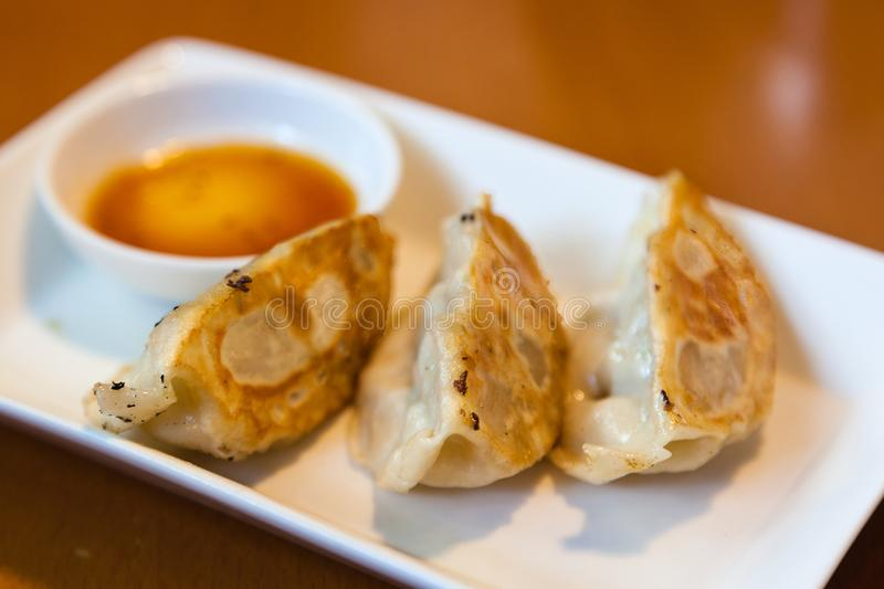 Download Close-up Gyoza Or Pot Stickers With Dipping Sauce Stock Photo -  Image of