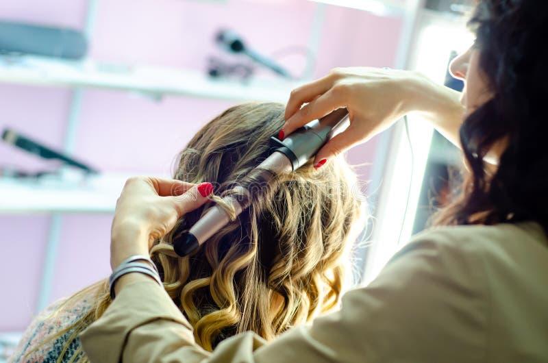 Hair Stylist Making Curls stock image