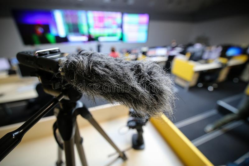 Close up of a hairy microphone or a microphone fitted with a fuzzy windscreen nicknamed. A windmuff or a `dead cat royalty free stock image