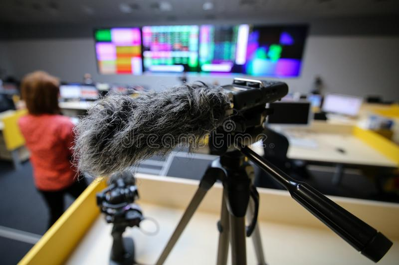 Close up of a hairy microphone or a microphone fitted with a fuzzy windscreen nicknamed. A windmuff or a `dead cat stock photos