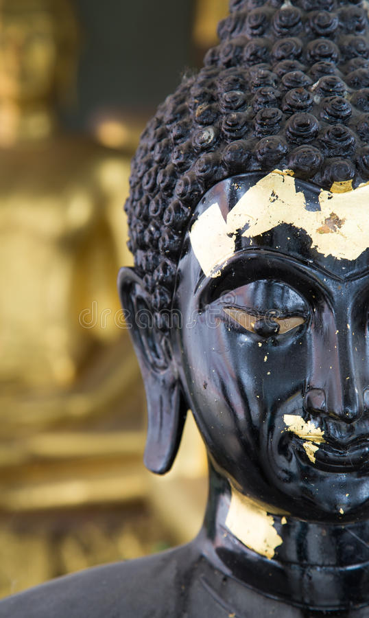 Download Close Up Half Face Of A Black Buddha Stock Photo
