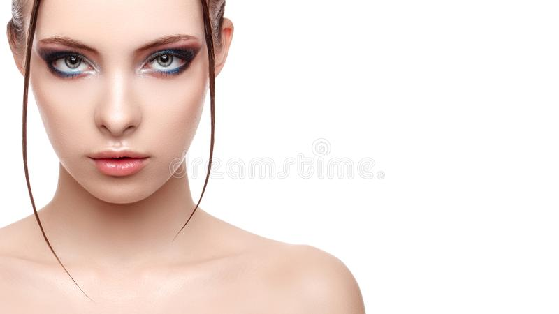 Close up half face portrait of model with glamorous makeup, wet effect on her face and body, high fashion and beauty royalty free stock photography