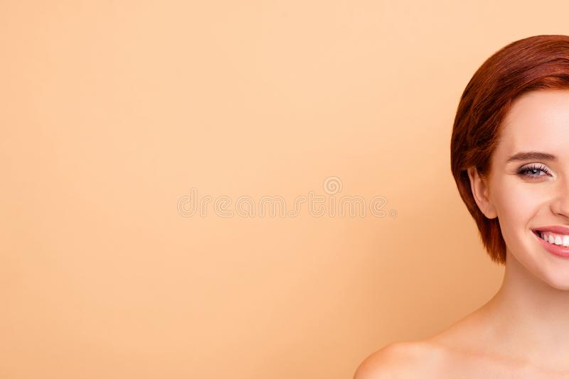 Close-up half-face portrait of nice lovely winsome attractive cheerful positive glad girl pure smooth clear perfect skin royalty free stock image