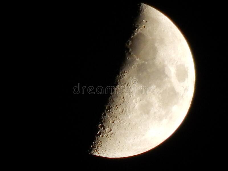 Close up of Half Moon. Beautiful and detailed view of half moon with visible craters stock photography