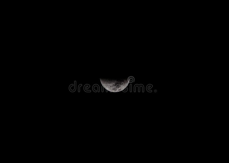 Close up of half moon in the dark sky royalty free stock photos