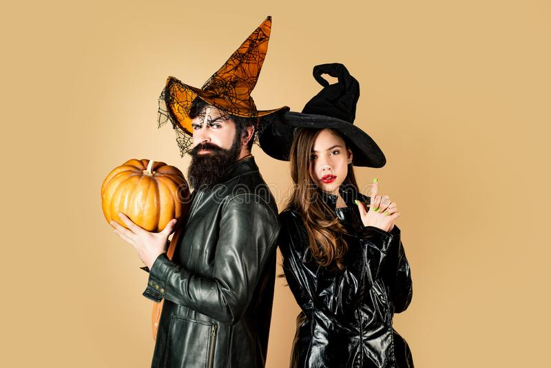 Close up Halloween portrait of funny couple. Two emotional young women and man in Halloween costumes on Halloween party royalty free stock photography