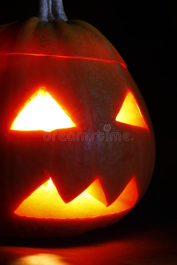 Close up of halloween pumpkin. On black background stock images