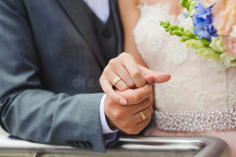 Close-up. Hand of bride and groom stock photography