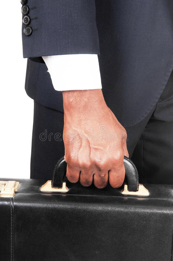 Close up of hand and briefcase of black man stock photos