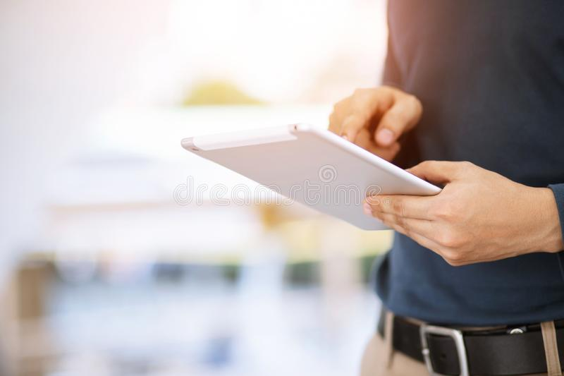 Close up hand  Business man working using a digital tablet pc device stock images
