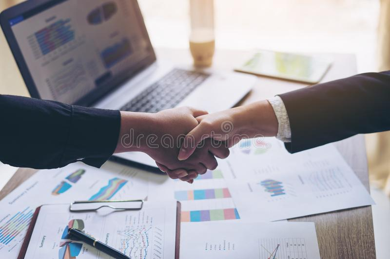 Close up hand of business people shaking hands finishing up meeting showing unity royalty free stock image
