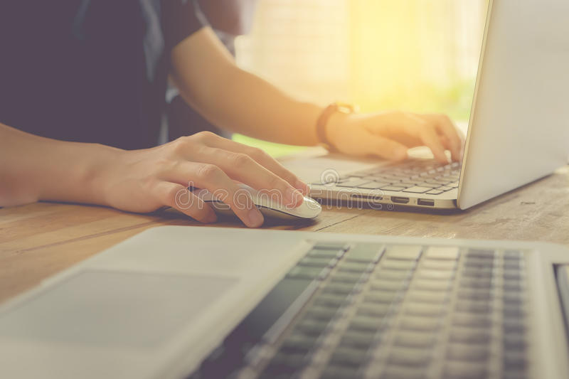close up hand business woman using mouse and laptop in office wi royalty free stock photos