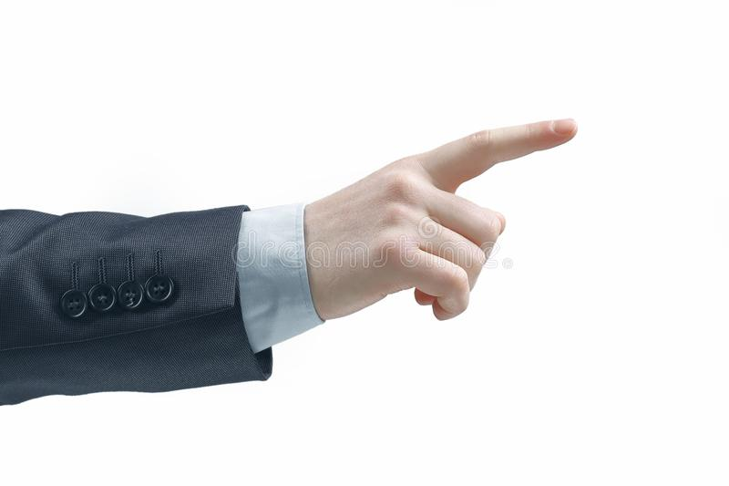 Close up. hand of a businessman pointing at a copy space.isolated on grey background stock image