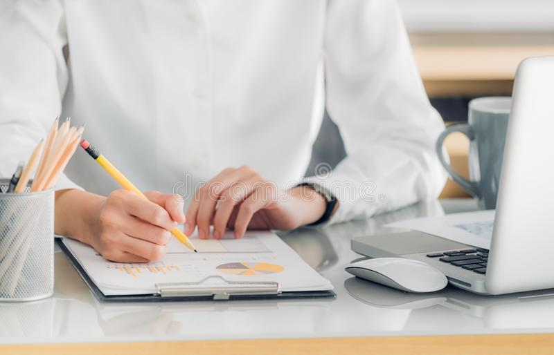 Close up hand of businesswoman hand writing a report in front o stock image