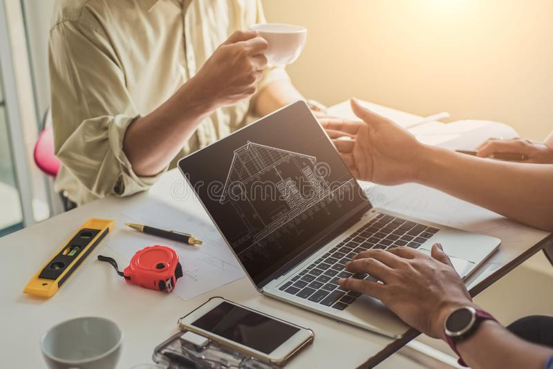 Close up hand of civil engineer or architect business working on blueprint architectural project at construction site at desk in royalty free stock photos