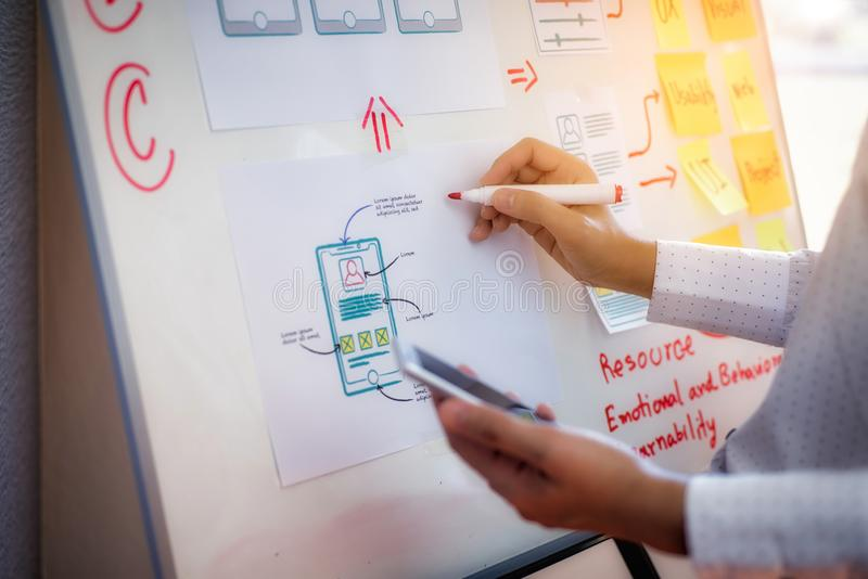 Close-up hand of designer woman sort layout of drawing application for developing for mobile applications. User experience Design royalty free stock photos