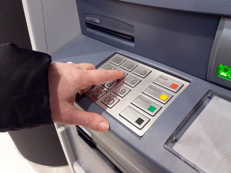 Close-up of hand entering PIN/pass code on ATM/bank machine keypad. royalty free stock photo