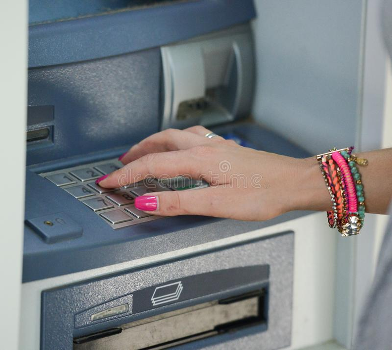 Close-up of hand entering PIN/pass code on ATM/bank machine keypad stock images