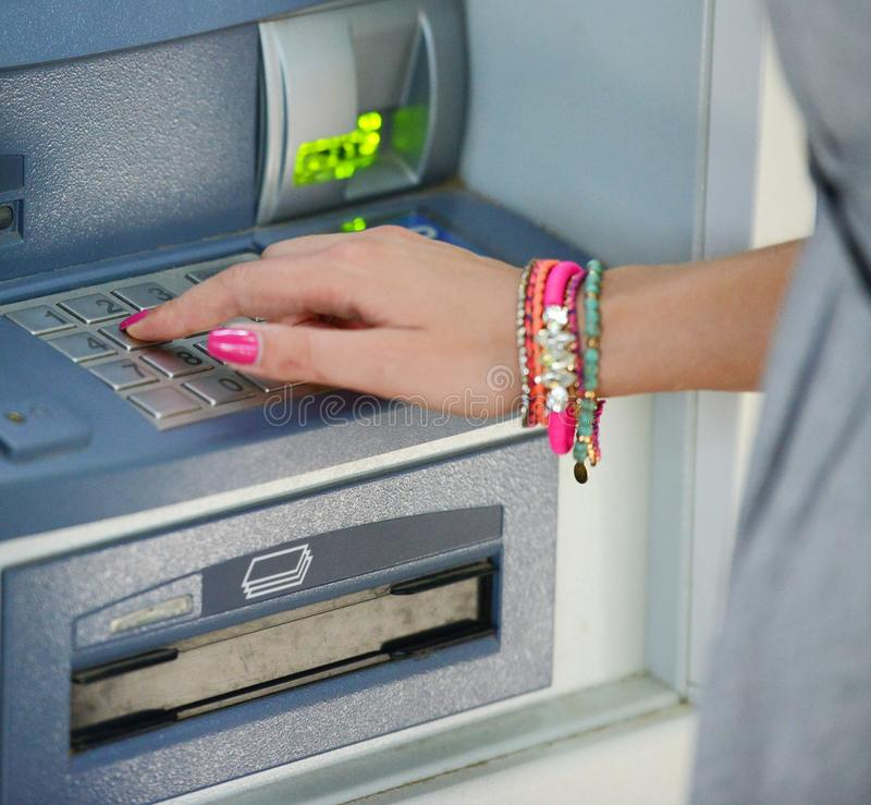 Close-up of hand entering PIN/pass code on ATM/bank machine keypad stock photography