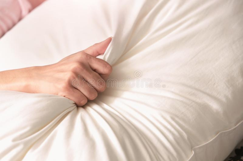 Close up hand of having sex on a bed. stock photo