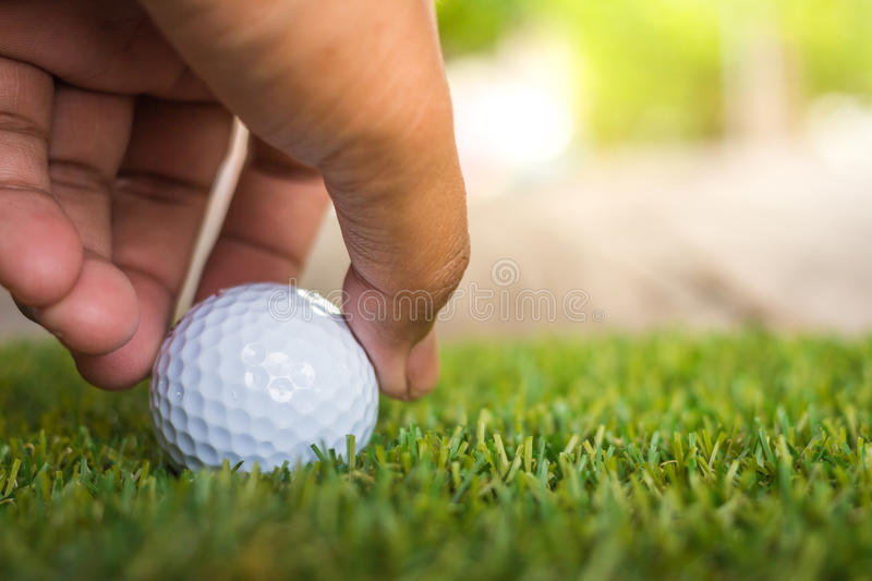 Close-up hand hold golf ball. Individual sports royalty free stock photo