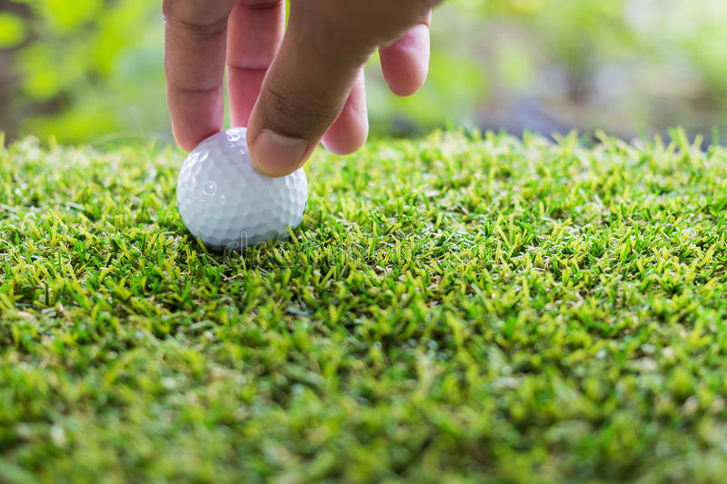 Close-up hand hold golf ball. Individual sports stock photography
