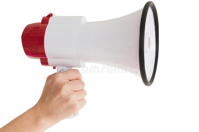 Close up of hand holding bullhorn. Over white background stock photo