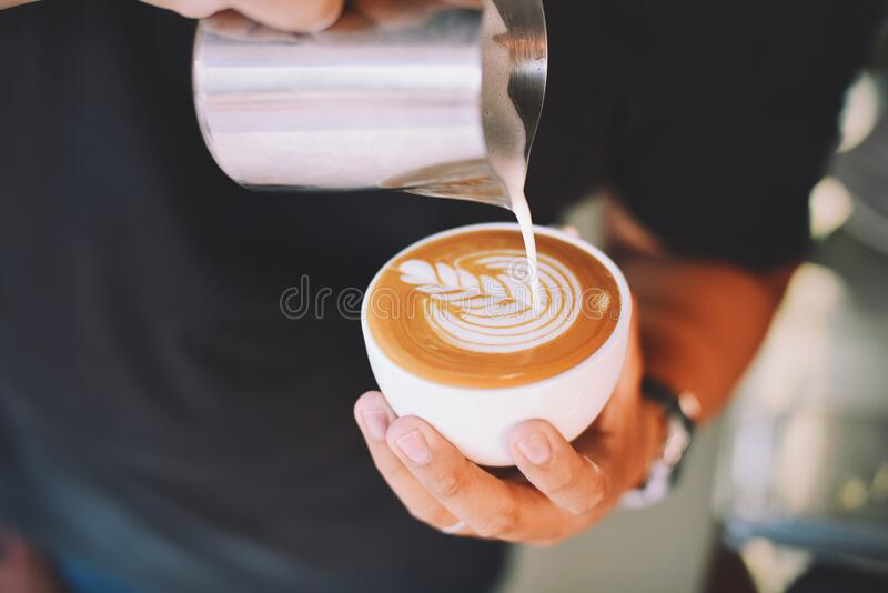 Close-up of Hand Holding Cappuccino royalty free stock photo