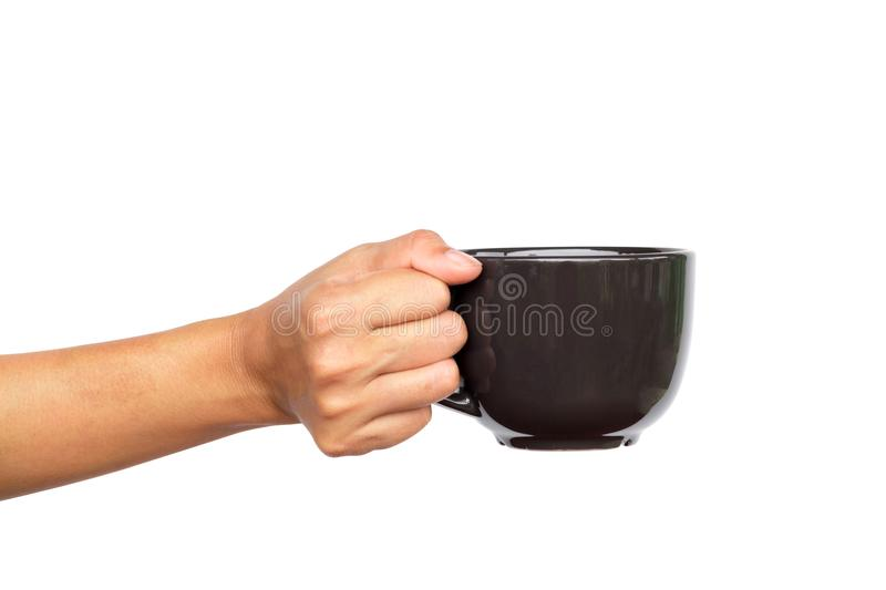 Close up of hand holding coffee cup. Close up of hand holding coffee cup on white background royalty free stock photos