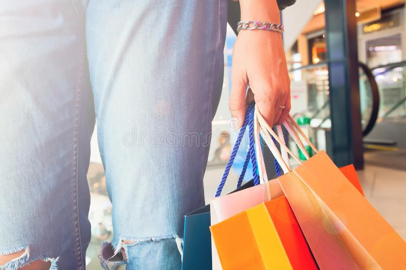 Close up hand holding shopping bags, Trendy lifestyle concept stock images
