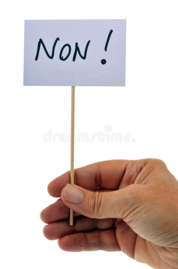 Close-up hand holding a sign on which is written in French royalty free stock photos