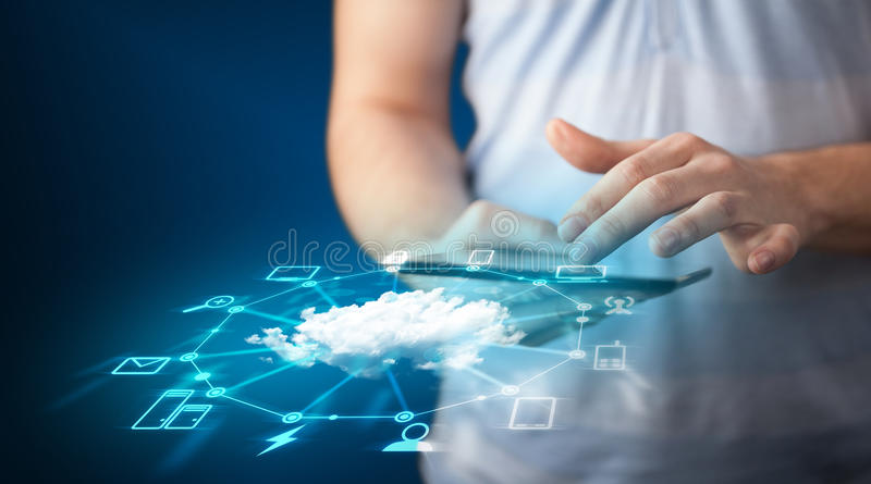 Close up of hand holding tablet with cloud network technology stock images